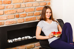 Attractive woman eating breakfast. Royalty Free Stock Photo