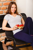 Attractive woman eating breakfast. Royalty Free Stock Photography