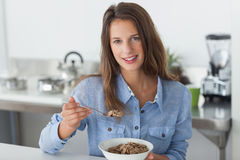 Attractive woman eating cereal Royalty Free Stock Photography