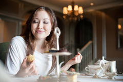 Attractive Woman Eating Desserts 2 Stock Photos