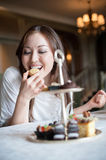 Attractive Woman Eating Desserts Stock Photography