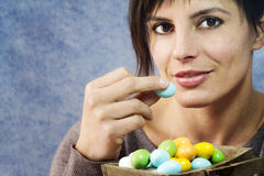 Attractive woman eating easter eggs Stock Image