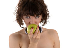 Attractive woman eating green apple Royalty Free Stock Photo