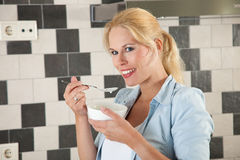 Attractive woman eating healthy Stock Photo