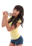 Attractive woman eating milk chocolate Stock Photography