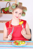 Attractive woman eating vegetables in the kitchen Royalty Free Stock Photo