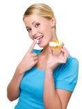 Attractive woman eats sweet white cream Royalty Free Stock Images
