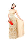 Attractive woman in elegant beige dress Royalty Free Stock Image
