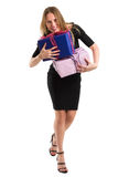 Attractive woman in elegant black dress with big gift packages Royalty Free Stock Image