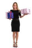 Attractive woman in elegant black dress with big gift packages Stock Photo