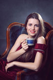 Elegant woman with cup of coffee Royalty Free Stock Photo