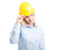 Attractive woman engineer holding her yellow helmet. Attractive woman engineer holding her protection yellow helmet and posing isolated on white background Stock Images