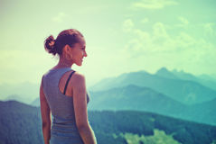 Attractive woman enjoying the beauty of nature Stock Photos