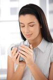 Attractive woman enjoying coffee Stock Photos