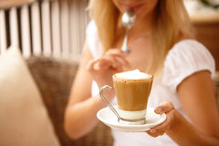 Attractive woman enjoying coffee on a vacation Royalty Free Stock Photography