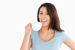 Attractive woman enjoying a cup of coffee Royalty Free Stock Photography