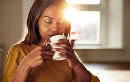 Attractive woman enjoying a cup of fresh coffee Stock Images