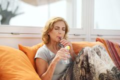 Attractive woman enjoying a fresh drink Royalty Free Stock Photos