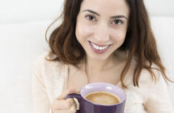 Attractive woman enjoying her cup of coffee Stock Photos