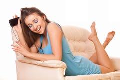 Attractive woman enjoying music stock photo