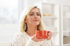 Attractive woman enjoying the smell of coffee in the morning Royalty Free Stock Photos