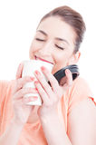 Attractive woman enjoying the smell of fresh coffee close-up Stock Photo