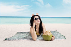 Attractive woman enjoying summertime at beach Stock Photography