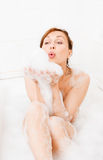 Attractive woman enjoys  in the bathtub. Stock Photography