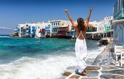 Attractive woman enjoys her holiday on Mykonos Island. Attractive woman in white dress enjoys her holiday on Mykonos Island, Cyclades, Greece Stock Photos