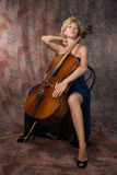 Attractive woman in evening dress with cello Stock Image