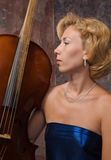 Attractive woman in evening dress with cello Royalty Free Stock Images