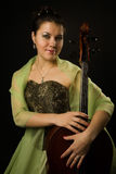 Attractive woman in evening dress with cello Royalty Free Stock Image