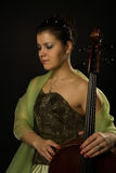 Attractive woman in evening dress with cello Stock Photography