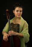 Attractive woman in evening dress with cello Stock Images