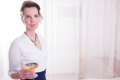 Attractive woman in evening outfit with glass of champagne Royalty Free Stock Images
