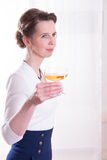 Attractive woman in evening outfit with glass of champagne Royalty Free Stock Photography