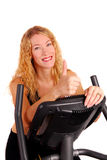 Attractive woman on exercise bike Stock Photo