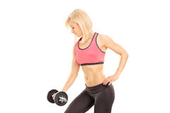 Attractive woman exercising with a barbell Stock Photography