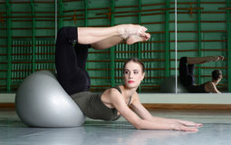 Attractive Woman Exercising With Exercise Ball. At dance hall royalty free stock images
