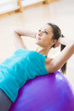 Attractive woman exercising with fitness ball Stock Photography