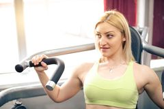 Attractive woman exercising at gym Royalty Free Stock Image