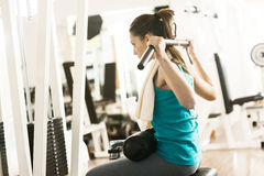 Attractive woman exercising at gym Stock Images