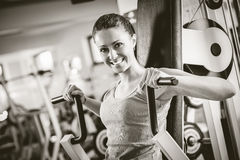 Attractive woman exercising at gym Royalty Free Stock Photos