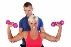 Attractive woman exercising with her coach Royalty Free Stock Photos