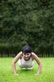 Attractive woman exercising outdoor Royalty Free Stock Image