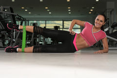 Attractive Woman Exercising With A Resistance Band Stock Photo