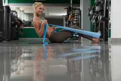 Attractive Woman Exercising With A Resistance Band Royalty Free Stock Photos
