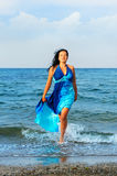 The attractive woman exit the sea Royalty Free Stock Photography
