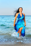 The attractive woman exit the sea Stock Photos