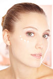 Attractive woman with eye cream Royalty Free Stock Images
